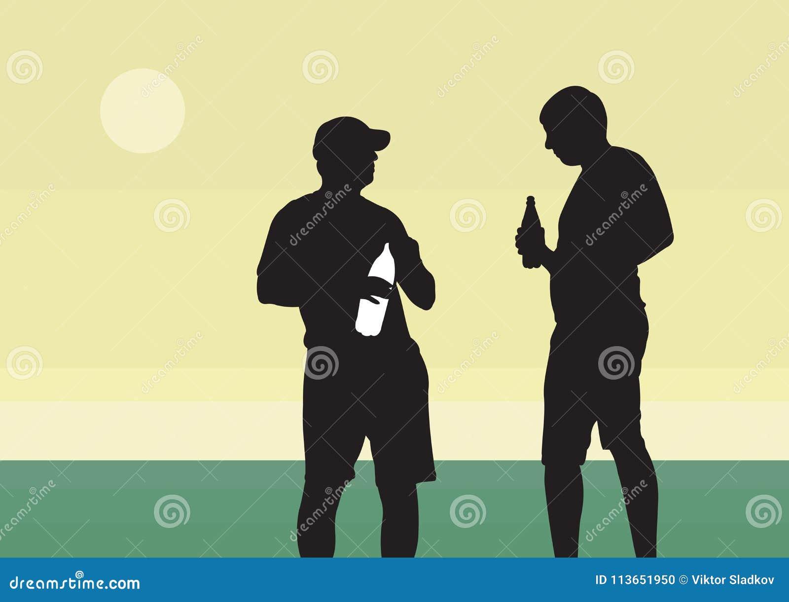 Dwa młodego faceta piją napój od butelki
