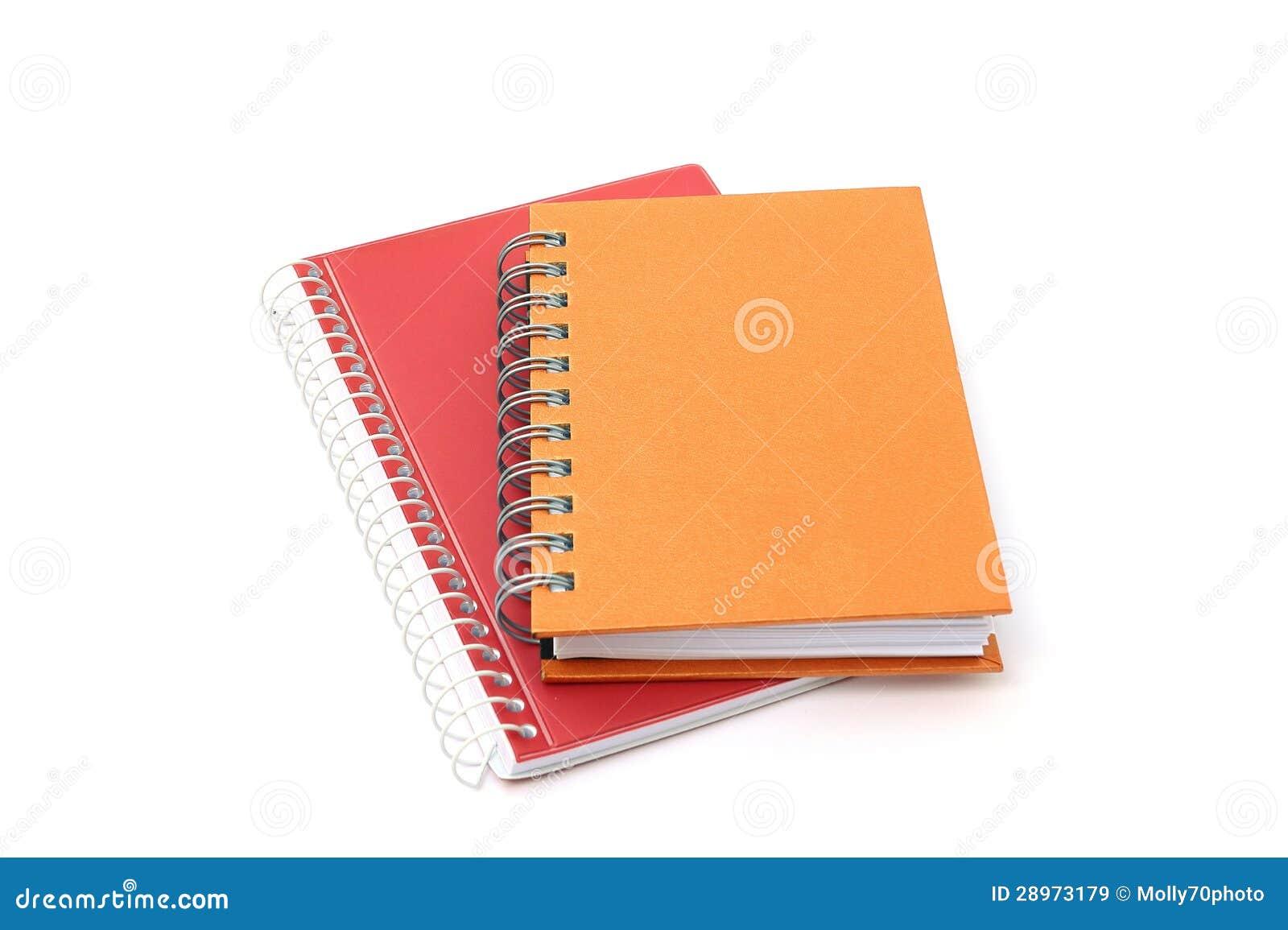 Dwa notatnika na białym tle