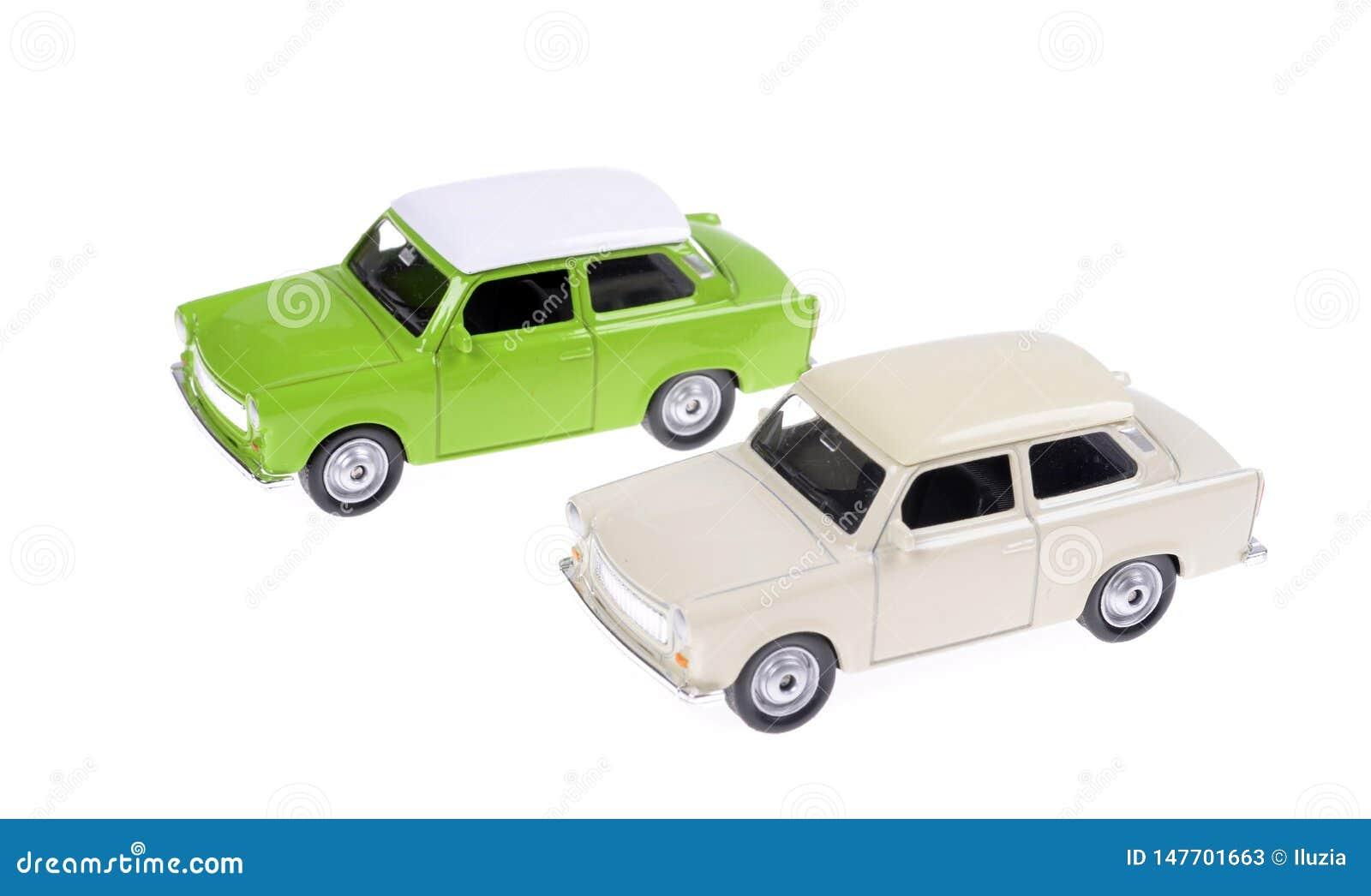 Dwa samochodu zabawki Retro zieleń i biel w 60s stylu odizolowywającym
