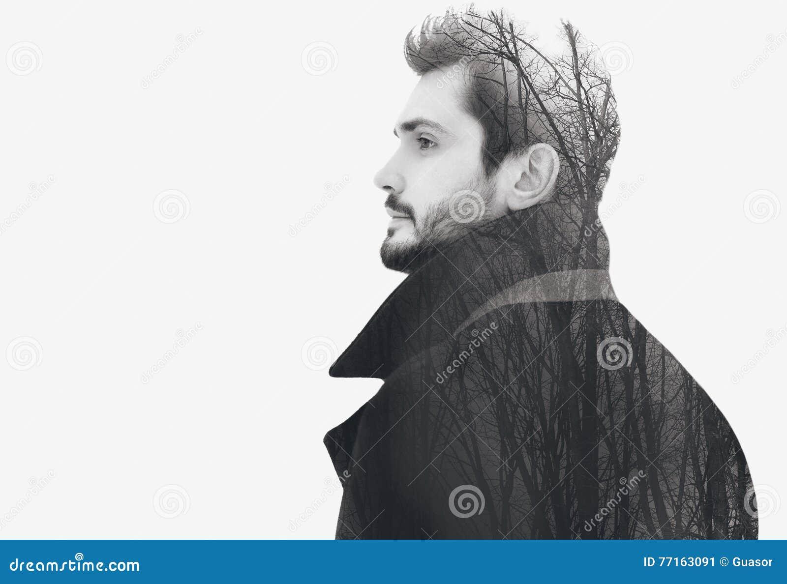 Dwoistego ujawnienia mody elegancki brodaty bezpłatny mężczyzna w profilowych zadumanych spojrzeniach
