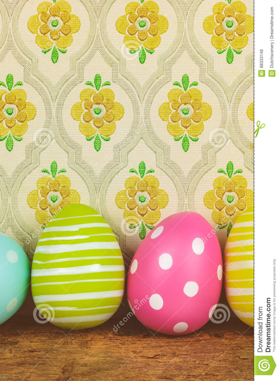 Dyed big easter eggs on a wooden table