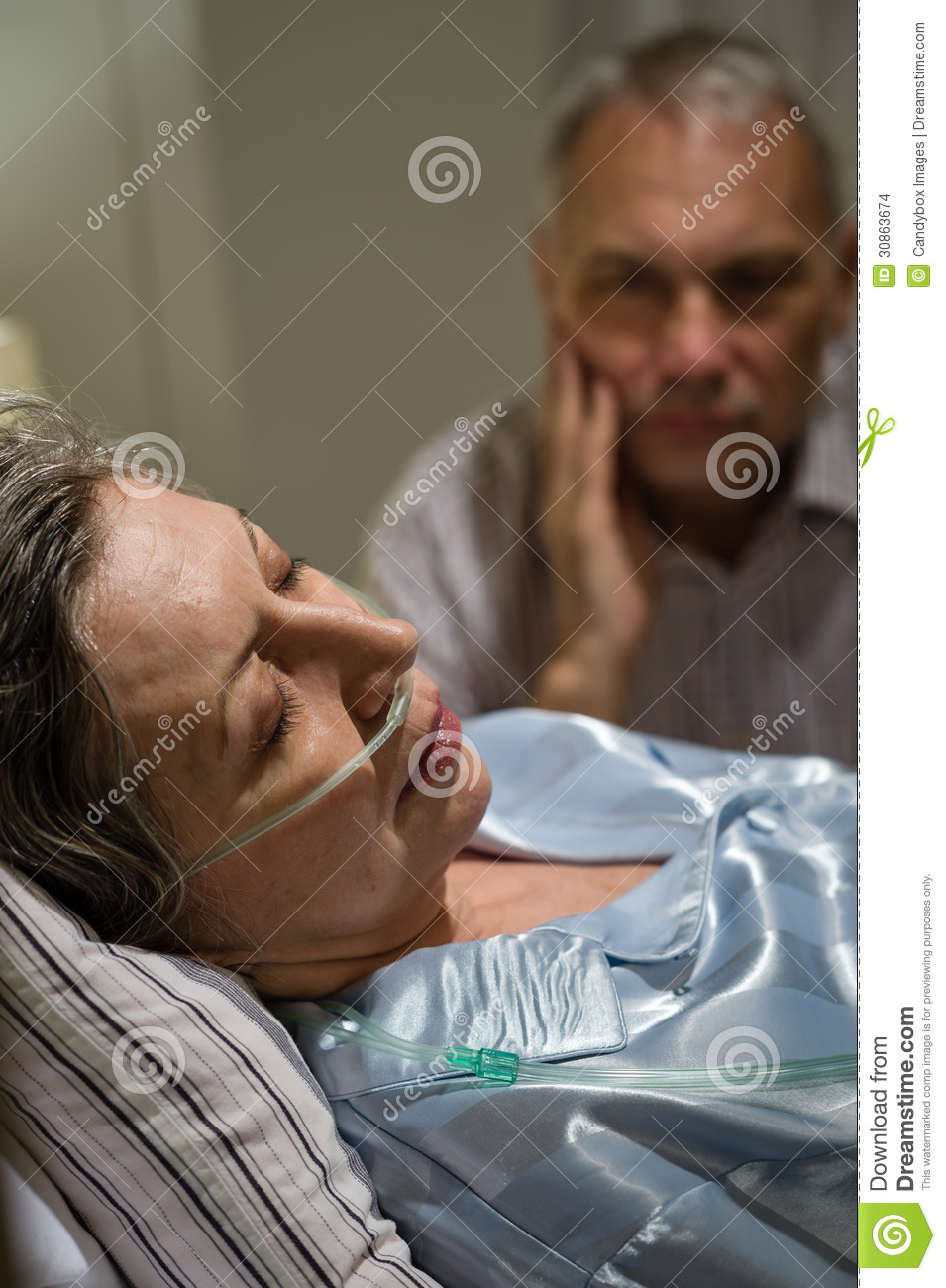 Dying Woman In Bed With Caring Man Stock Images - Image -4799