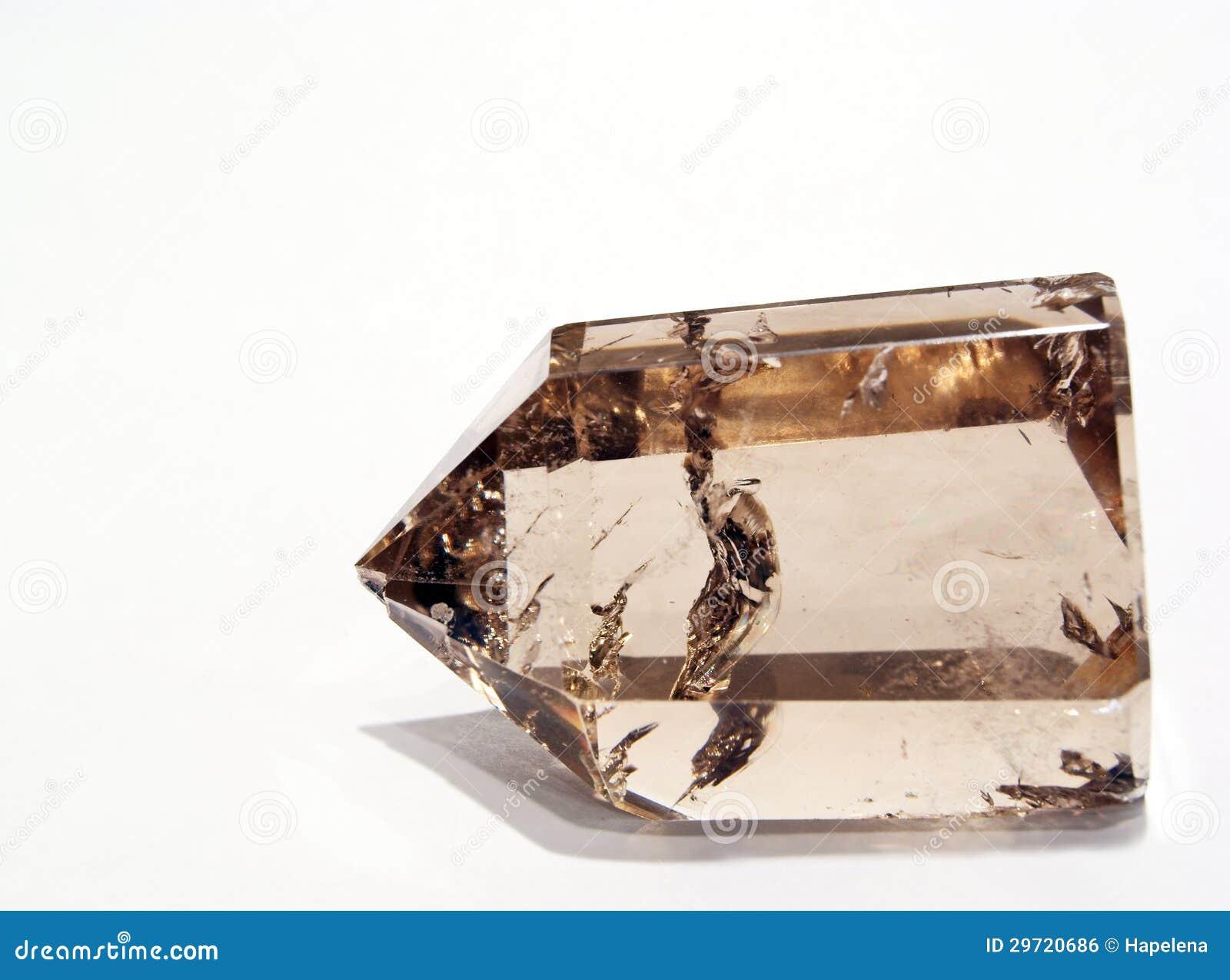 Dymiący Kwarcowy kryształ w sztucznym świetle