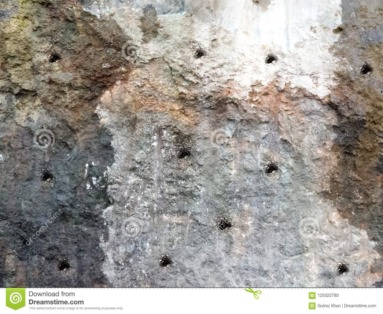 Dynamite Holes for explosive filing on a Mountain Rock