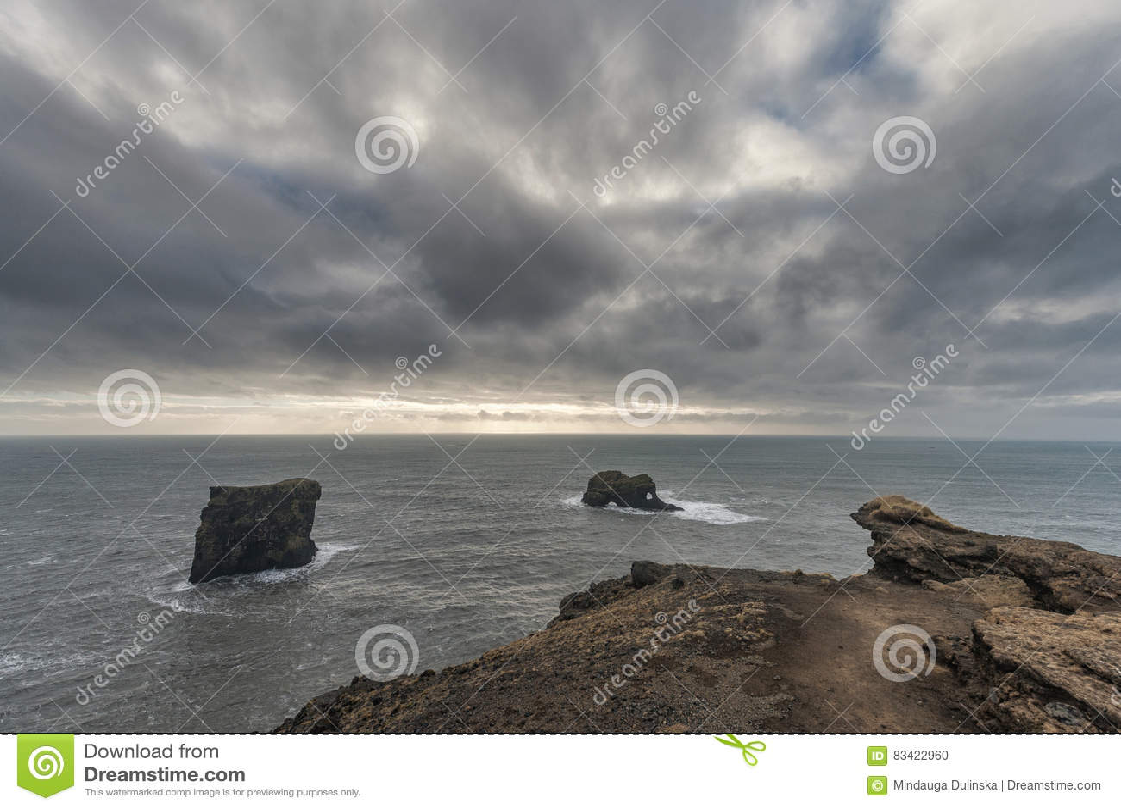 Dyrholaey Area in Iceland. Close to Black Sand Beach. Cloudy Sky