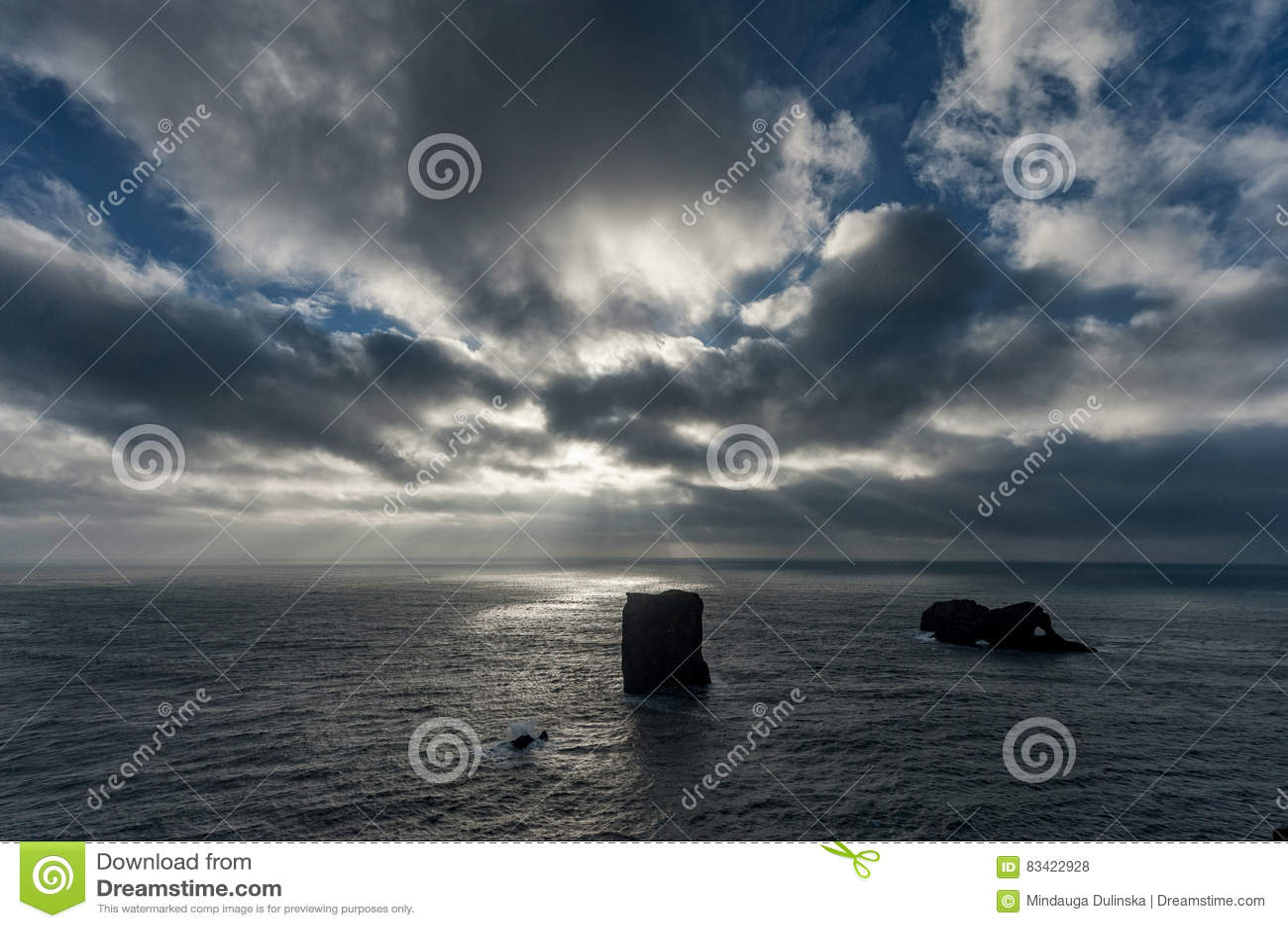 Dyrholaey Area in Iceland. Close to Black Sand Beach. Sunrise. Cloudy Sky
