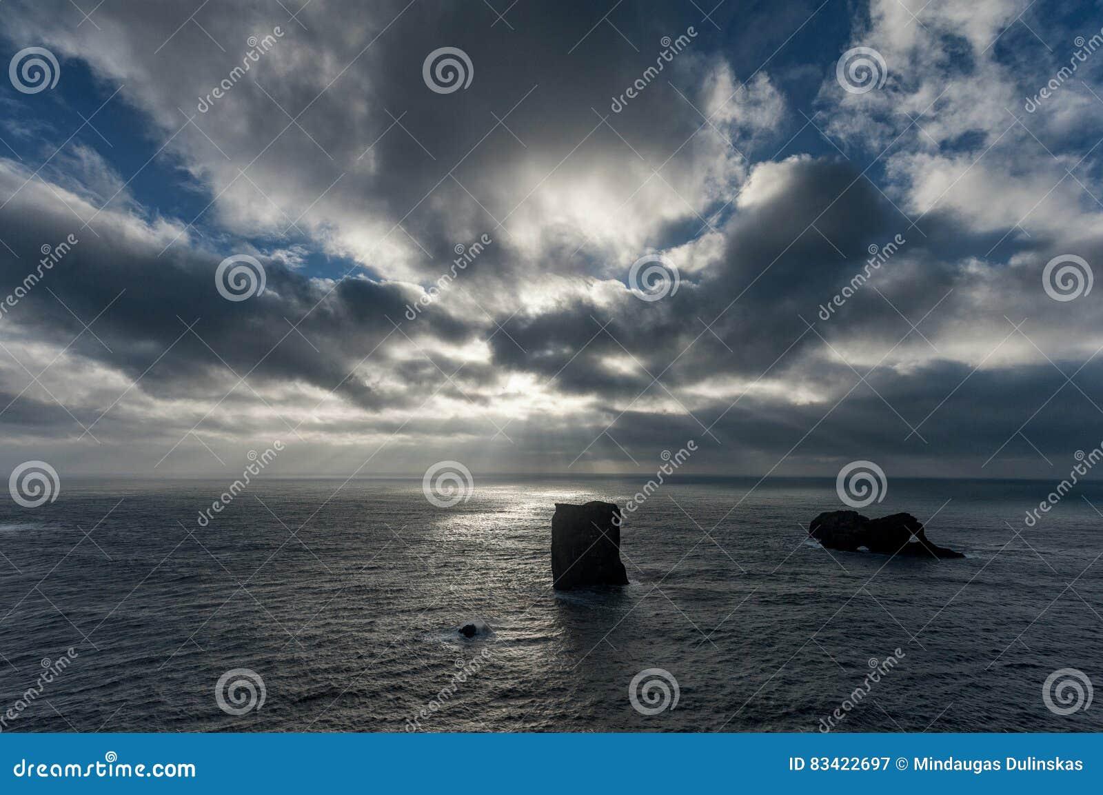 Dyrholaey Area in Iceland. Close to Black Sand Beach. Sunrise. Sunlight. Cloudy Sky