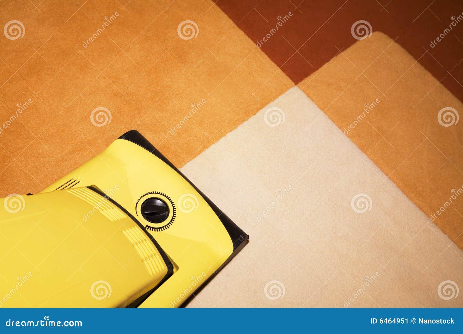 Dywanowy próżno czyściciel żółty