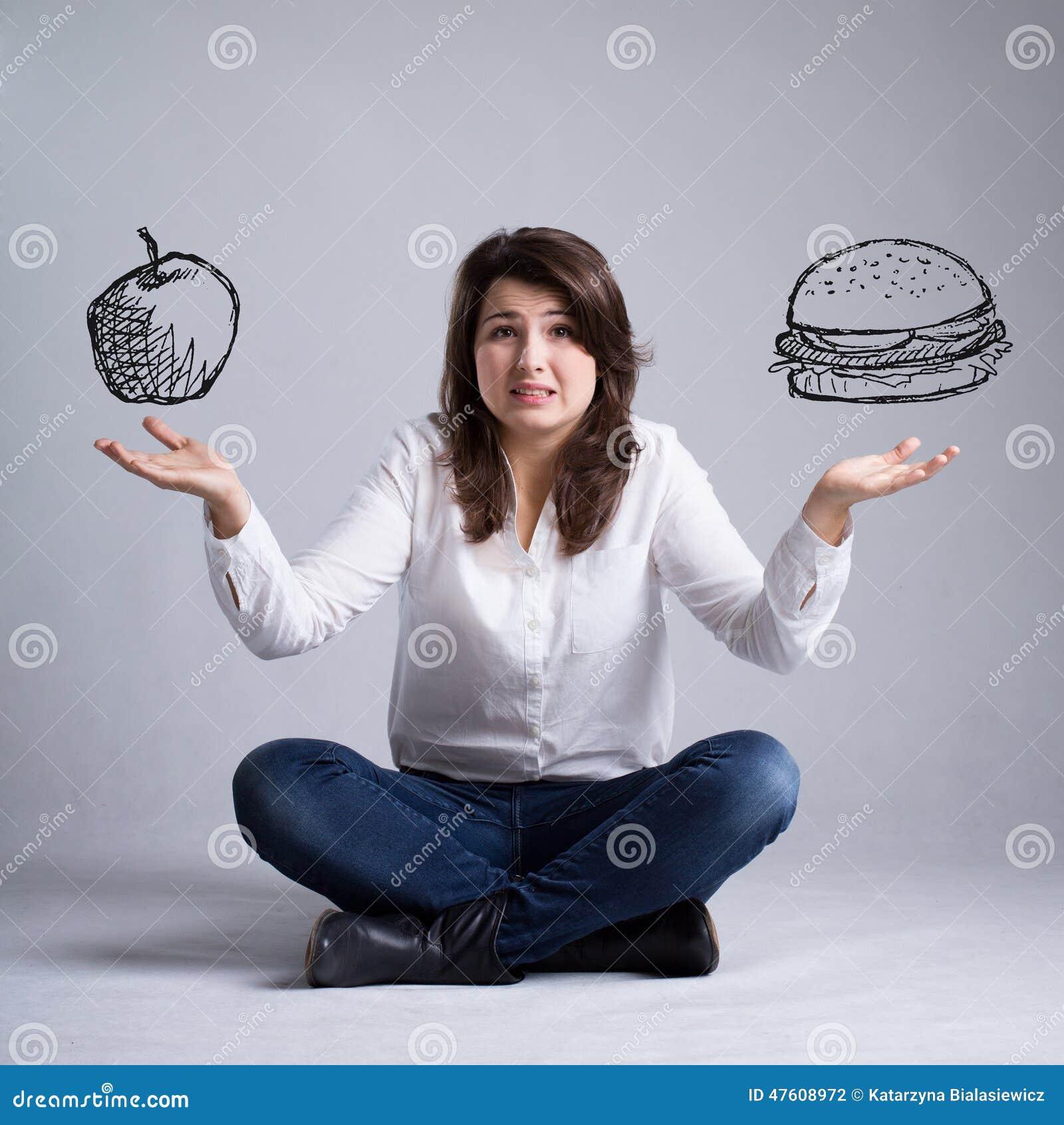 Dziewczyna z dylematem o jedzeniu