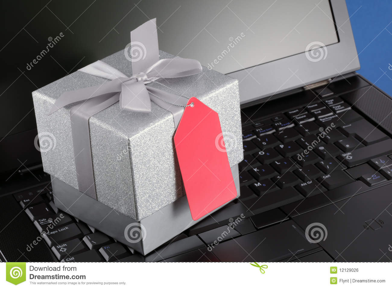 E commerce gift with blank tag and laptop