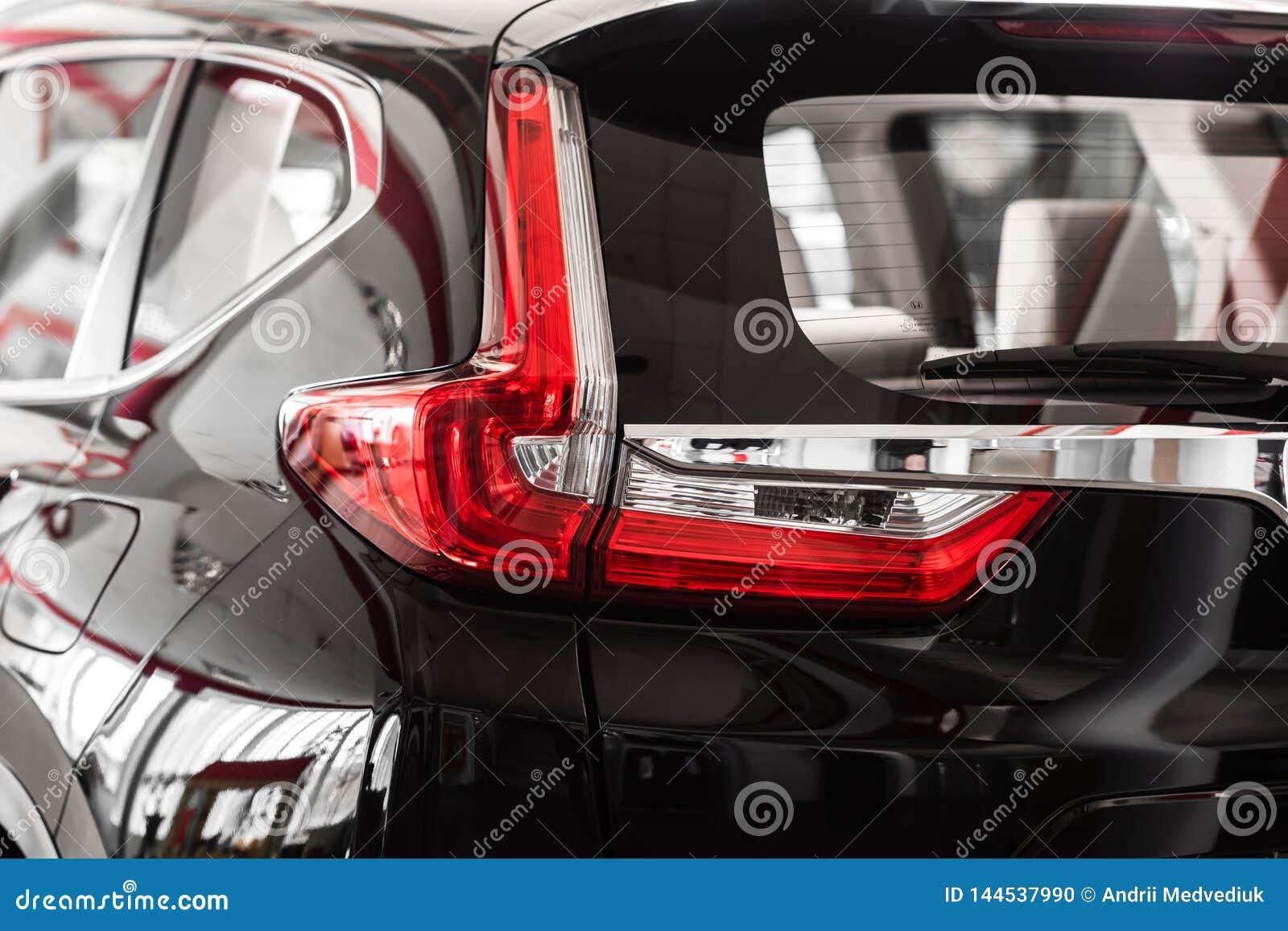 E De Koplamp van de auto De rug van de auto