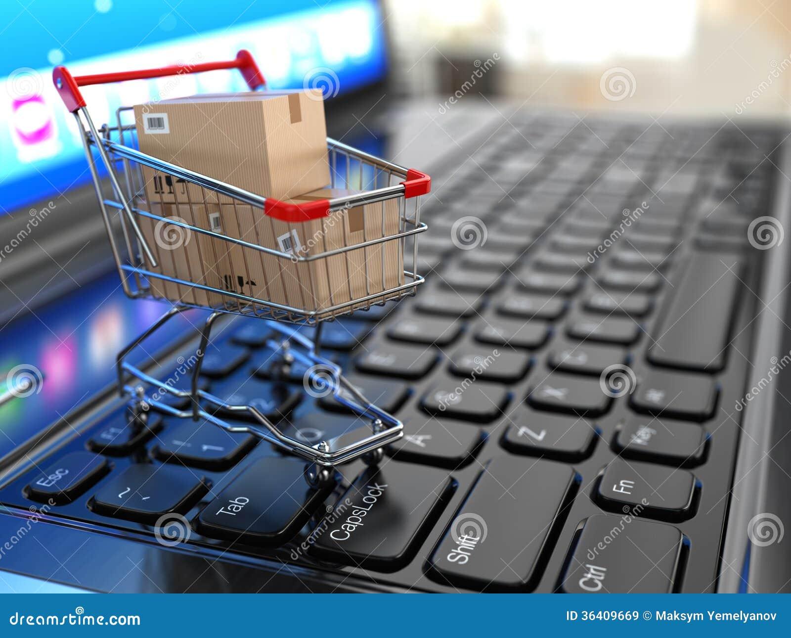 E-kommers. Shoppingvagn med kartonger på bärbara datorn.