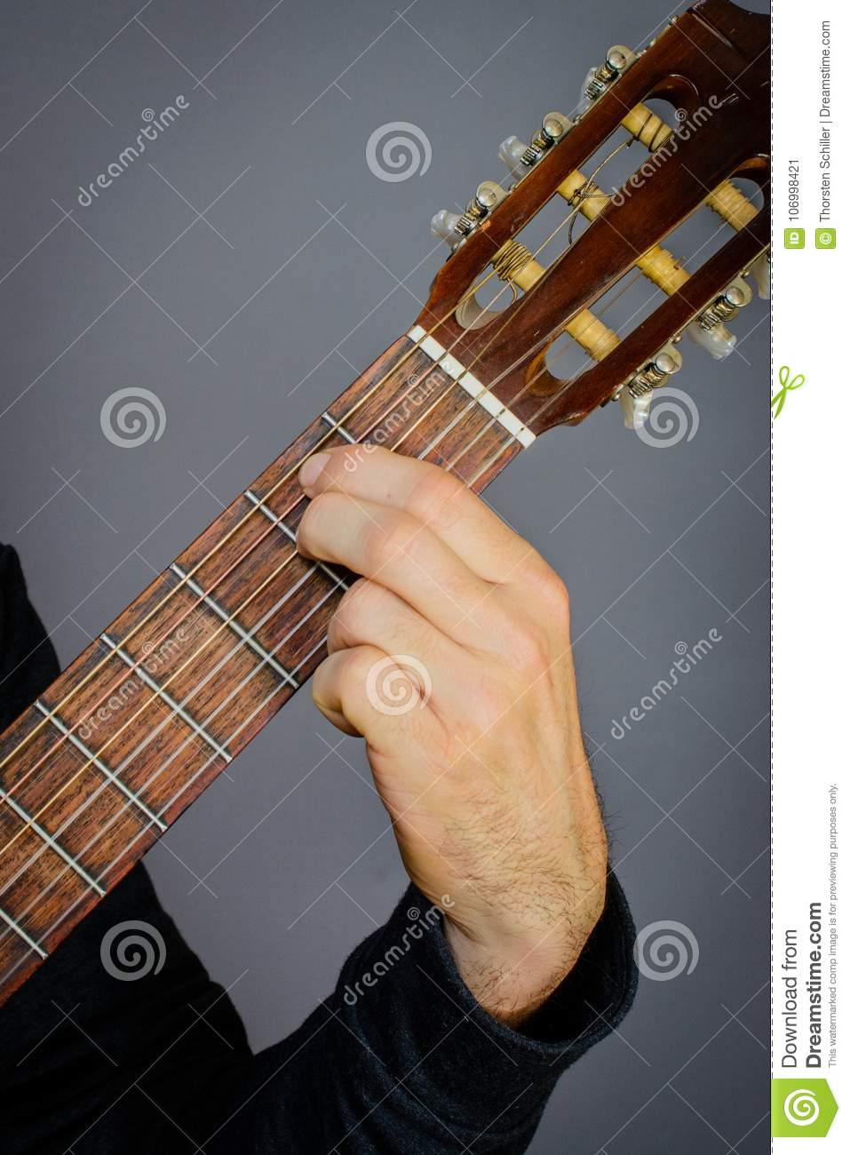 E Minor Chord Played By Guitarist On Classical Acoustic Guitar Stock