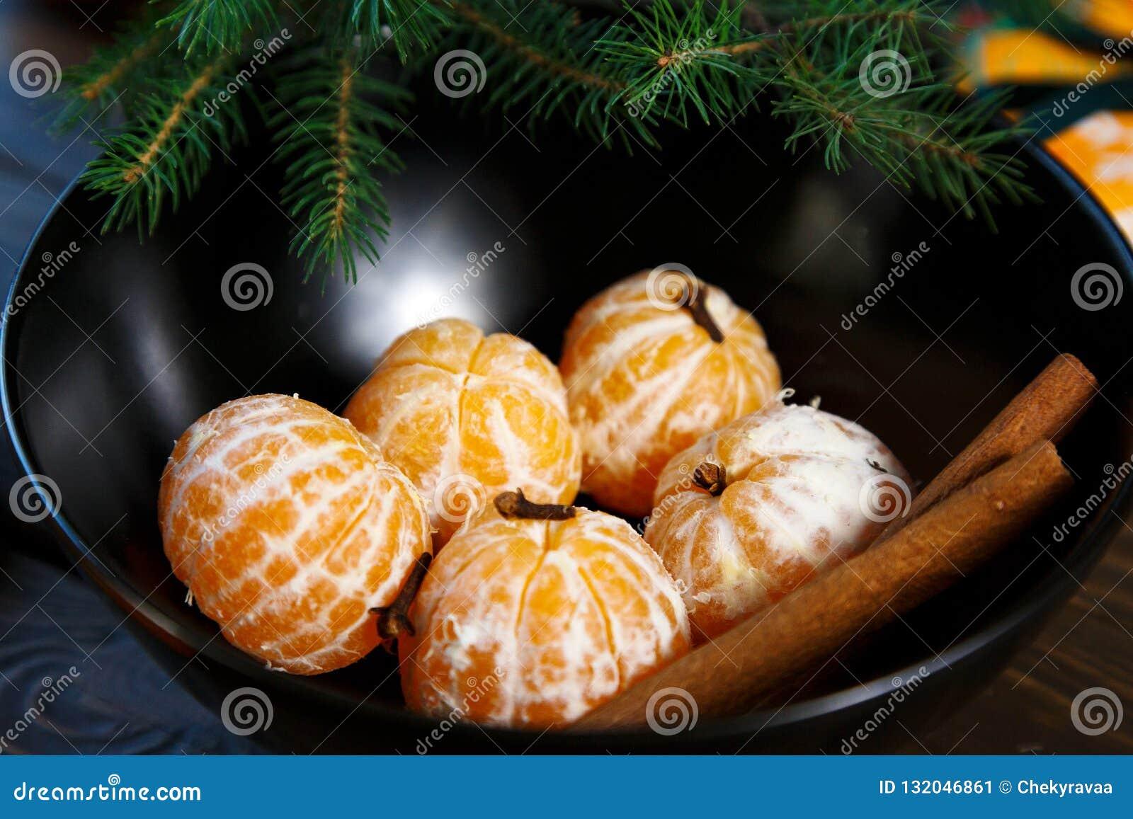 E Os mandarino das citrinas na placa