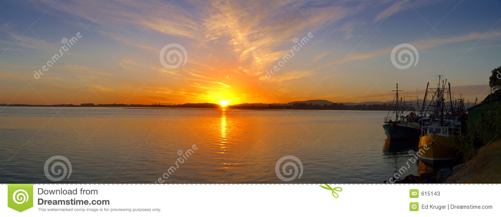 Early morning sunrise over fishing harbor