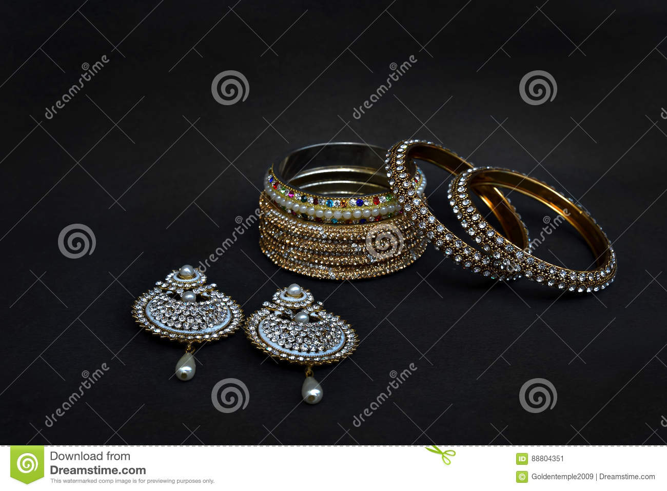 Earrings And Bangles With Silver And Gold Coated Stock Image