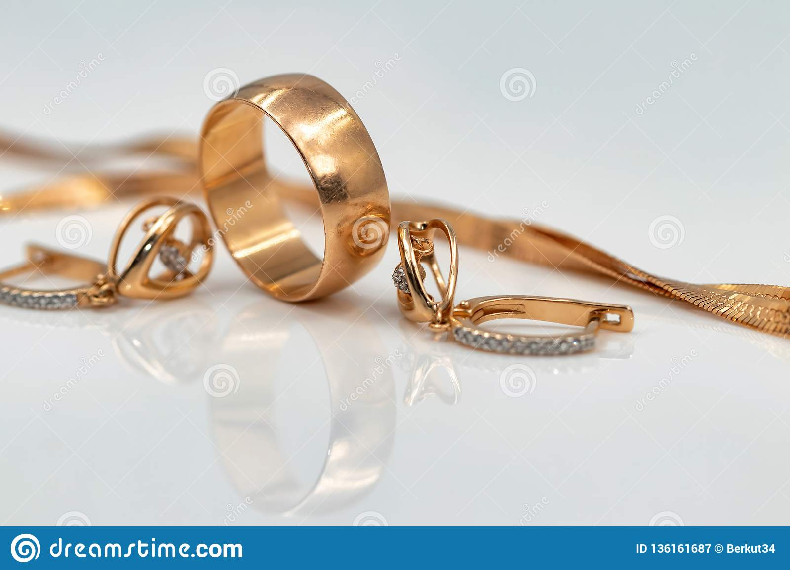 Earrings With Dancing Diamonds Gold Ring And Gold Chain Stock Image Image Of Earrings Rich 136161687