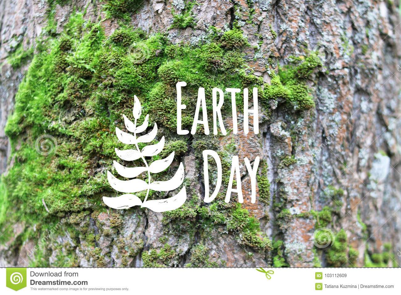 Earth day card decorated hand drawn leave on the green moss tree bark background