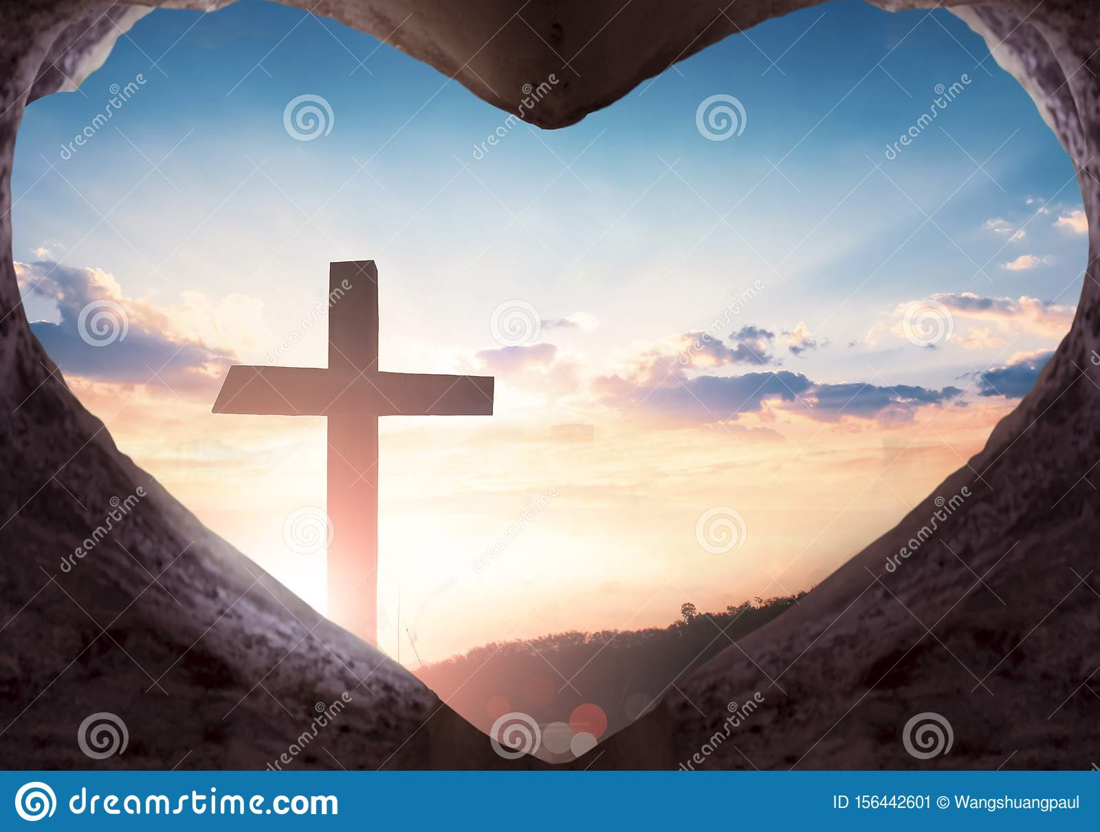 Easter concept: Jesus Christ empty grave on the cross background