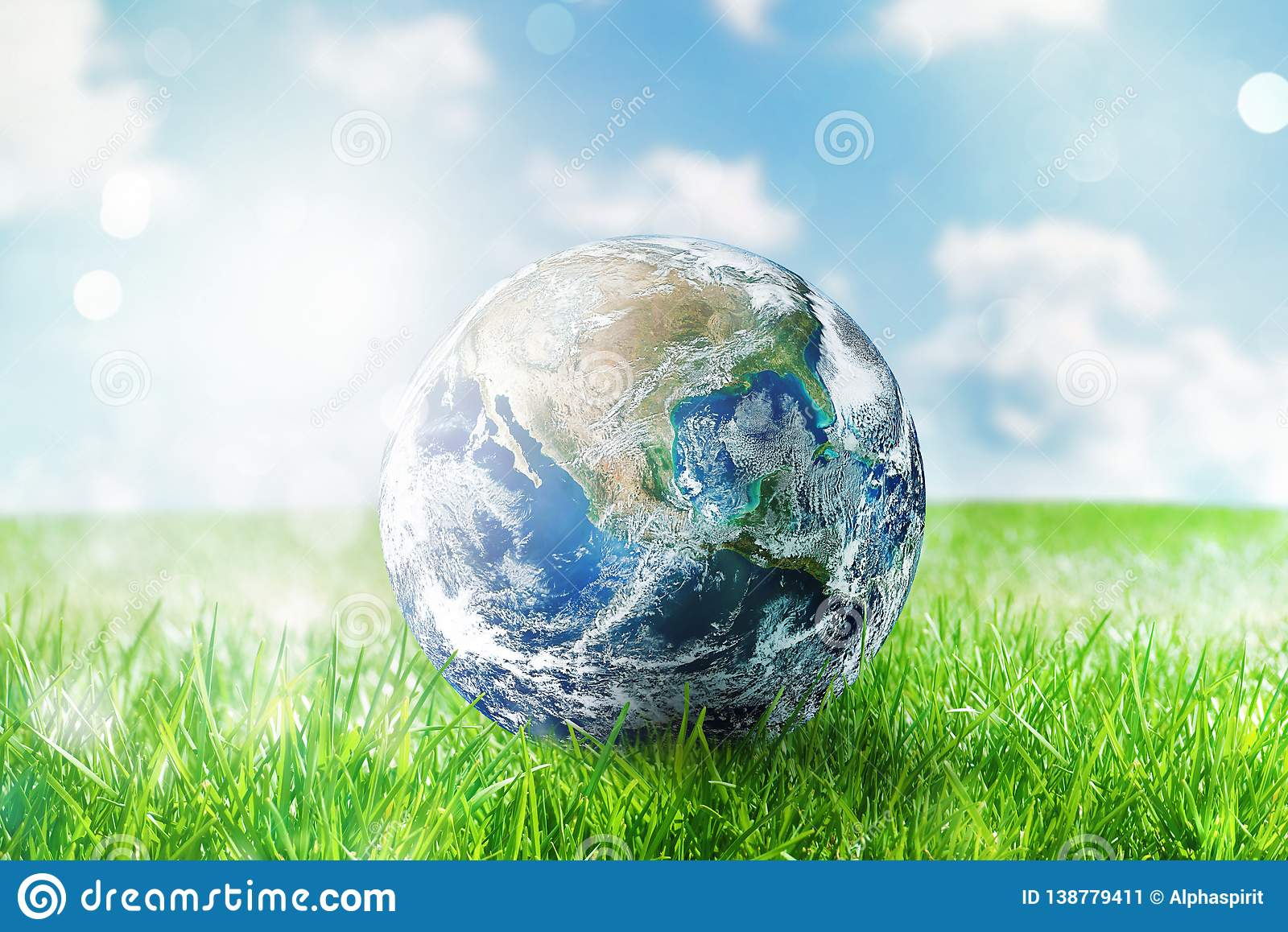 Earth globe in a green pristine field. World provided by NASA