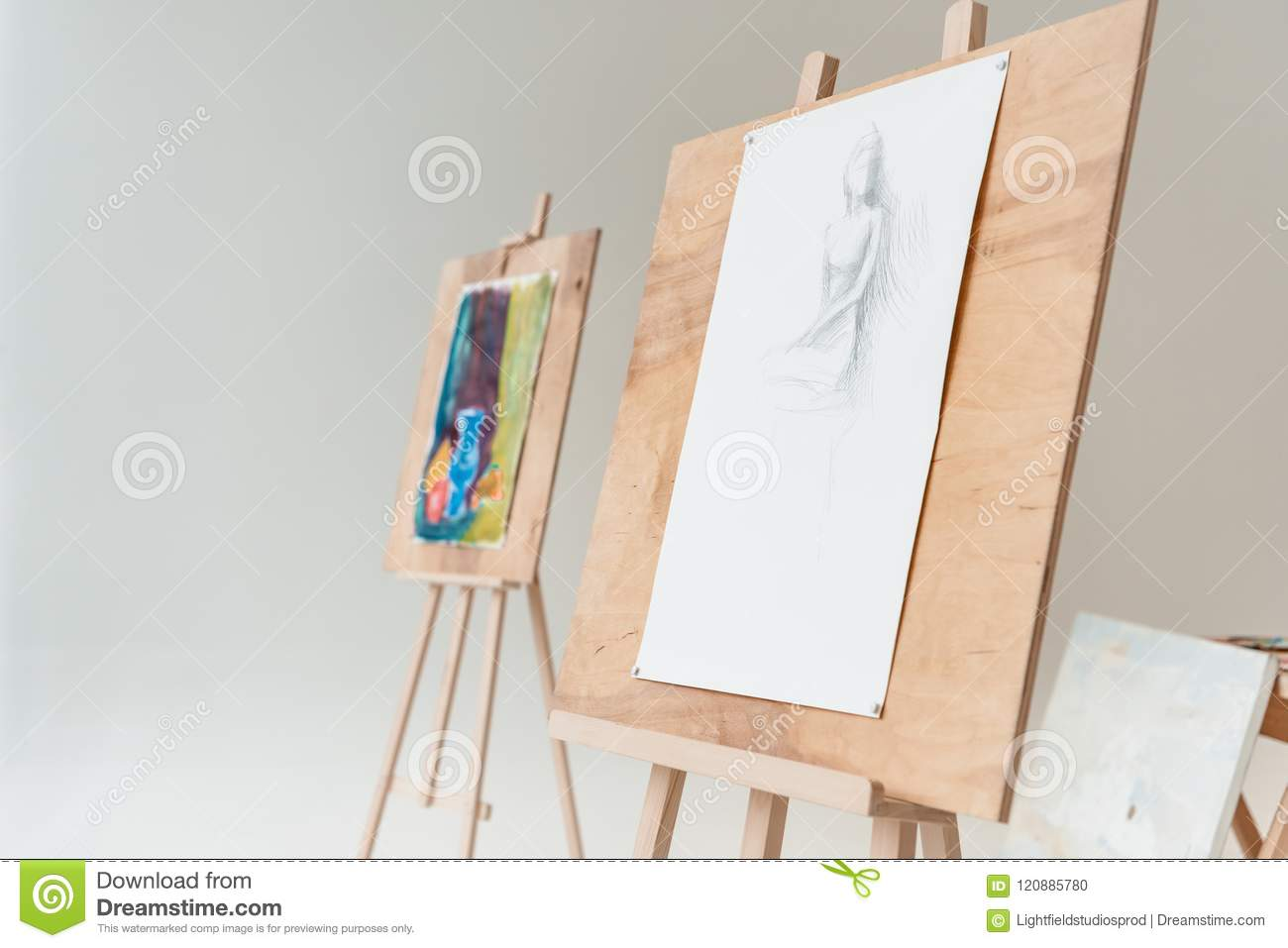 Easels With Artistic Paintings In Empty Art Studio Stock