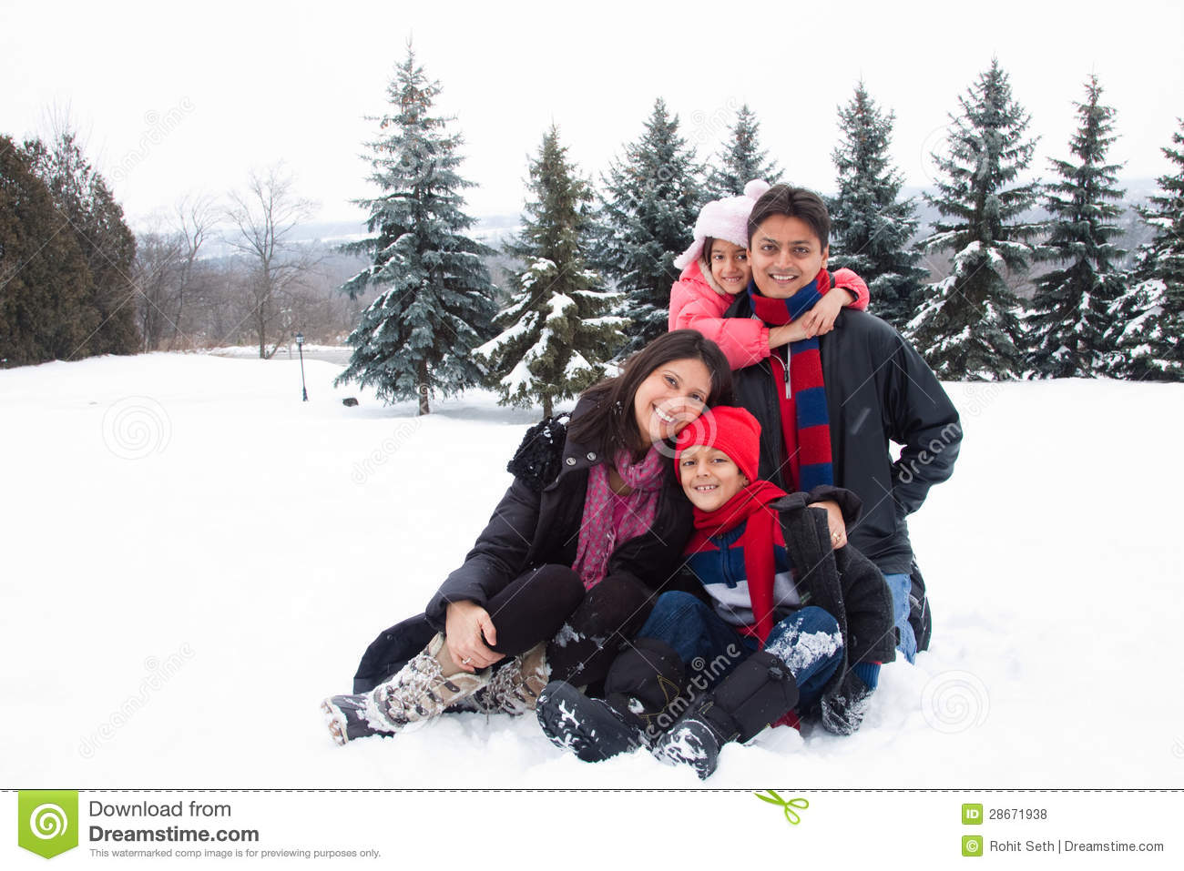 east indian family playing in the snow royalty free stock