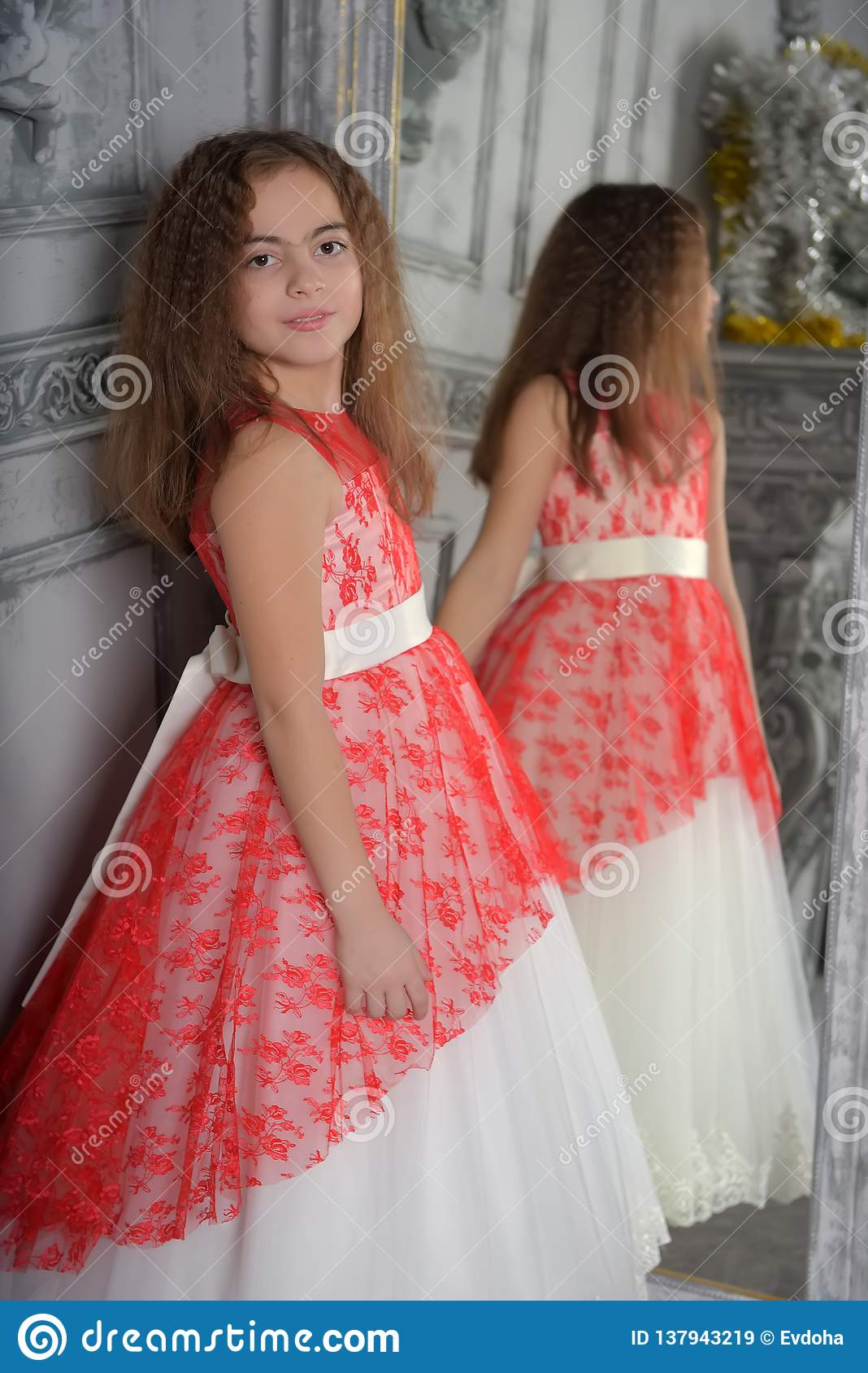 East type the girl the brunette in white with a red elegant dress
