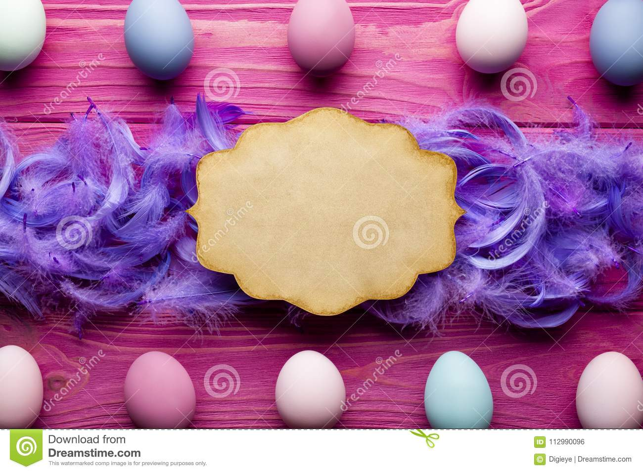 Easter background - blank paper label, colored eggs and feathers