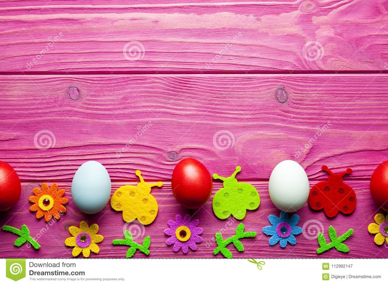 Easter background - colored eggs and colorful decorations