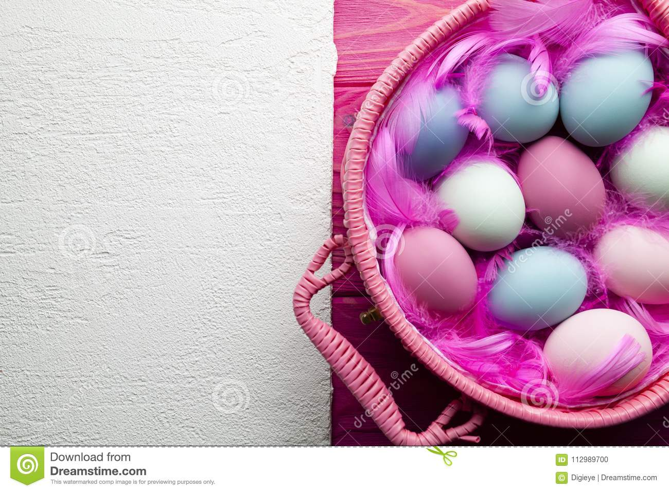 Easter background - white plastered surface and colored eggs