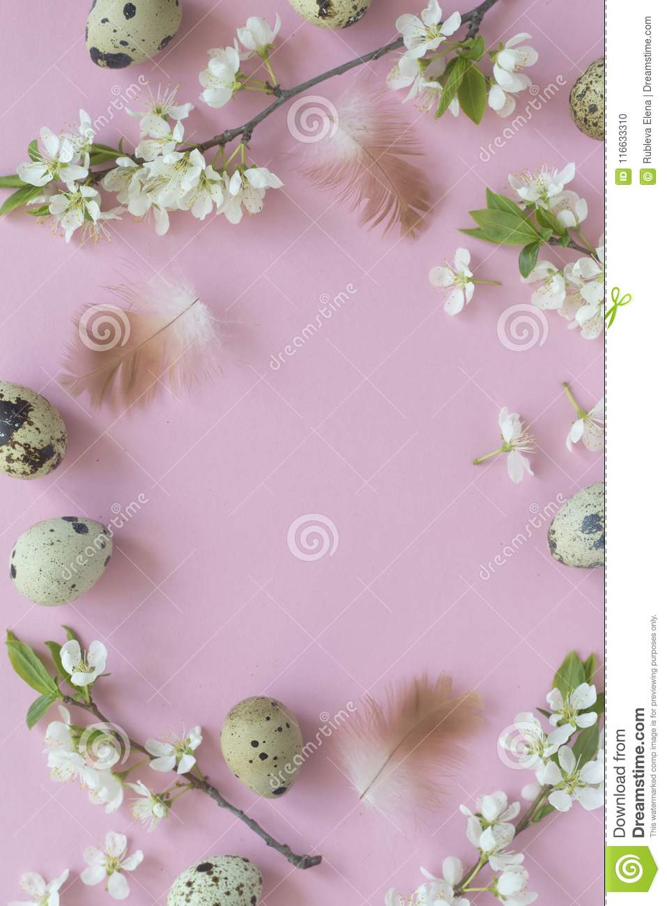 Easter backgroundwith eggs and blossom over light pink pastel background, top view with space for your text.