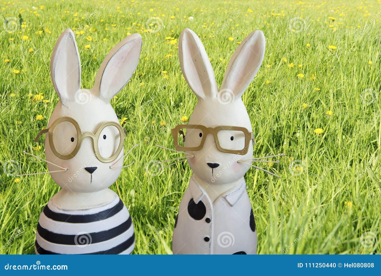 Happy easter - Easter bunnies in spring meadow