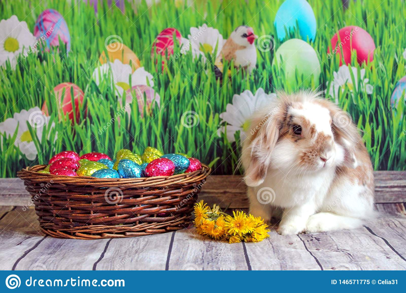 Easter bunny, cute rabbit with a basket of Easter eggs