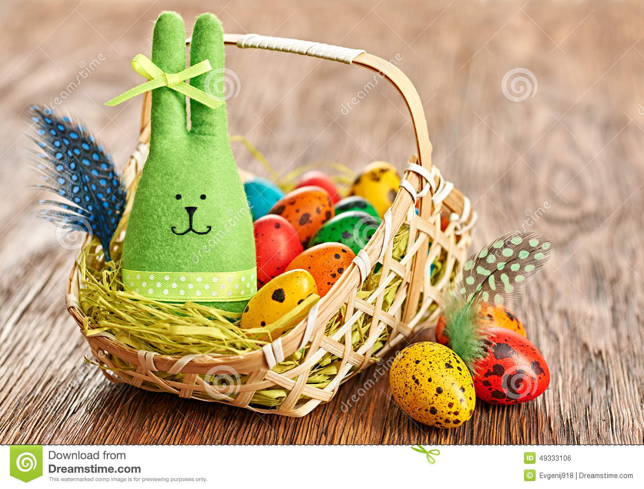 Handmade Wooden Easter Baskets : Easter bunny and painted eggs in basket on wooden