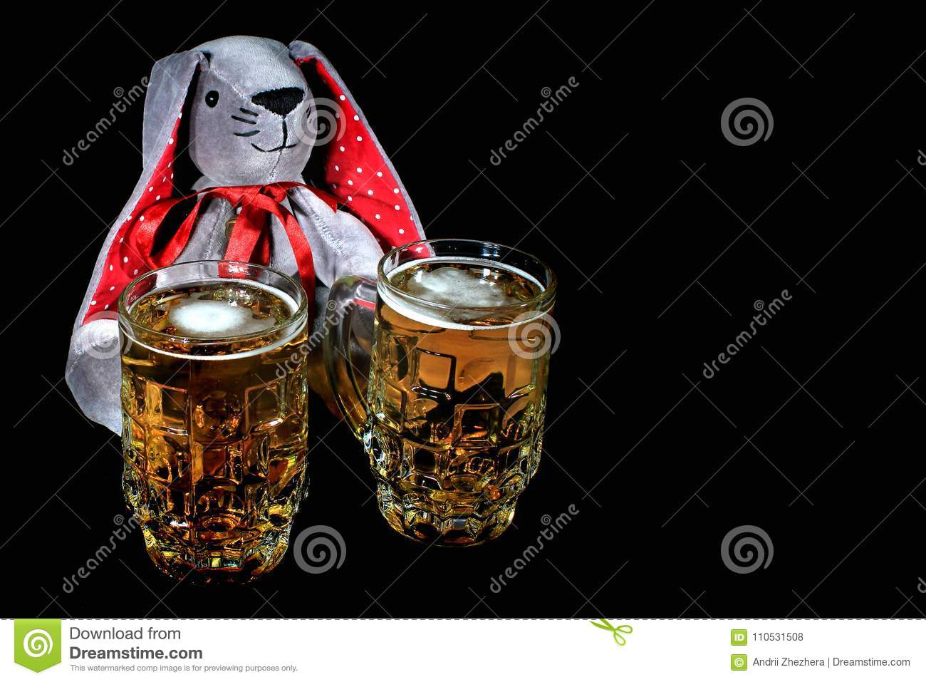 Easter Bunny With Two Mugs Of Beer Against Black Background Stock