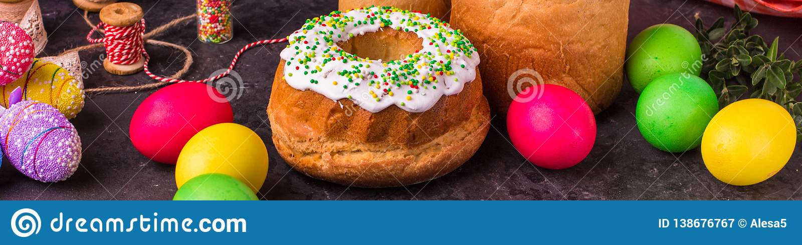 Easter cake and Easter eggs, traditional holiday attributes Happy Easter!. food background. top view