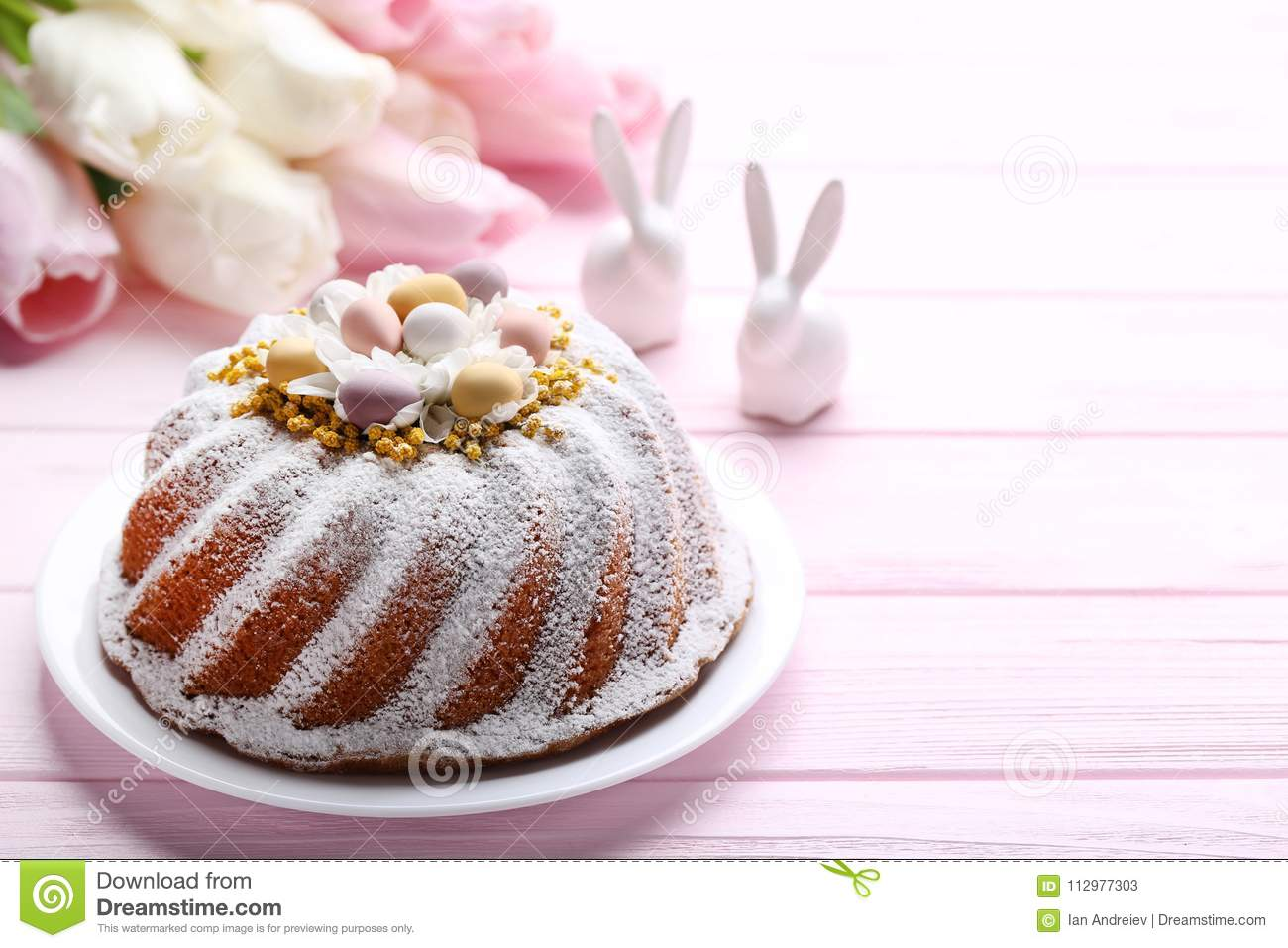 Easter cake with rabbits and tulip flowers
