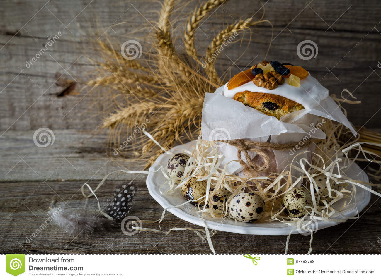 Easter cakes with eggs, rustic wood background