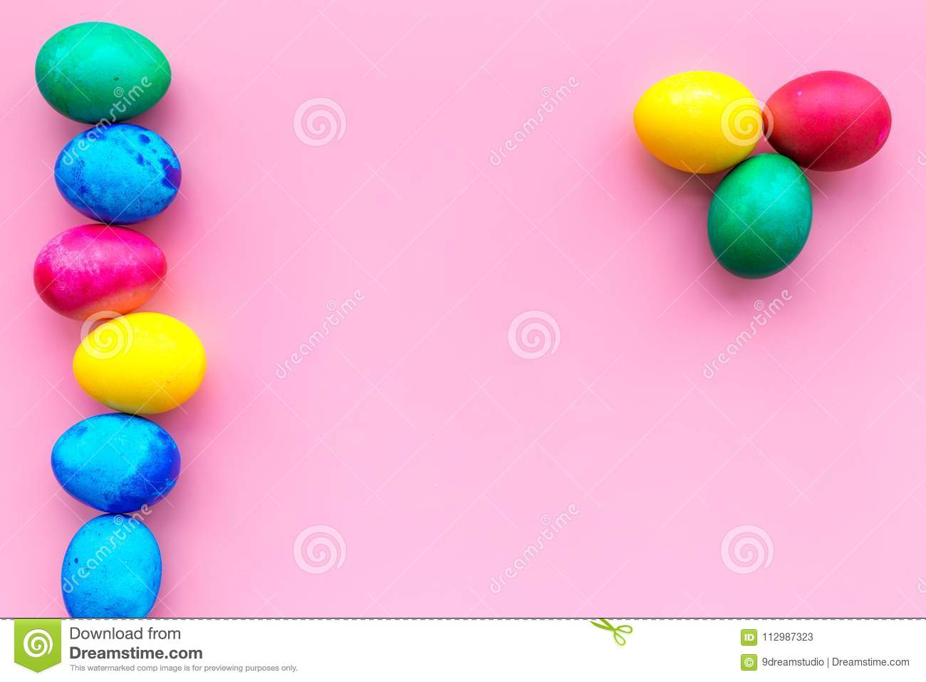 Easter celebration with colorful eggs. Pink background top view mock up
