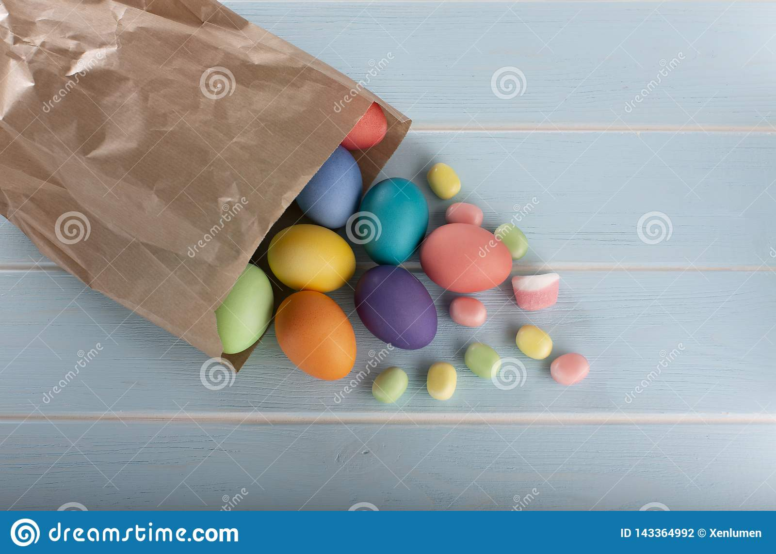 Easter colorful dyed chicken eggs in a paper bag