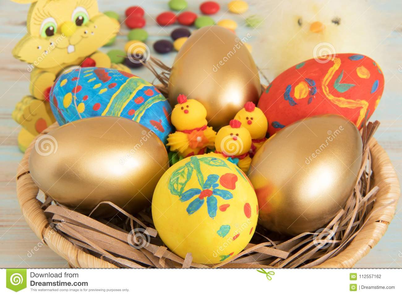 Symbolic Easter Attributes Eggs In A Basket With Yellow Baby Chicken