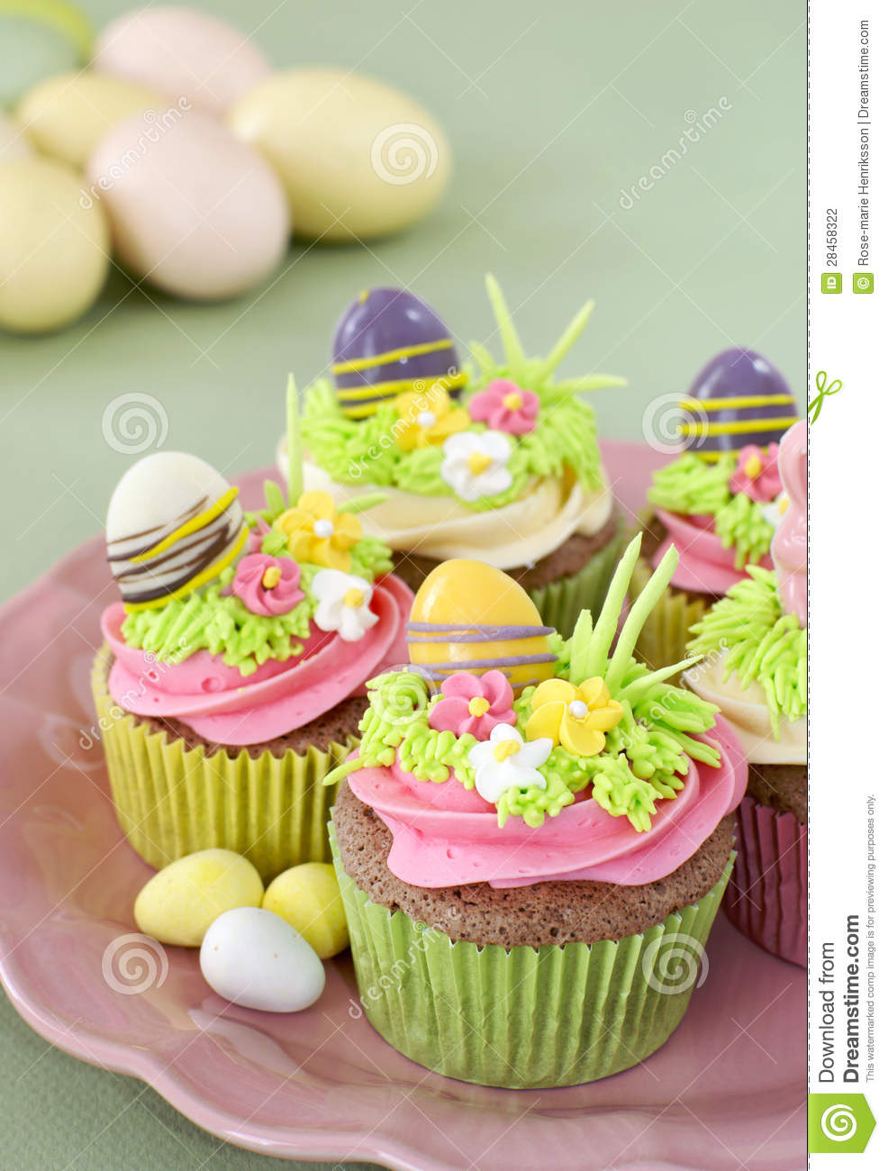 Chocolate cupcakes with vanilla frosting decorated for Easter.
