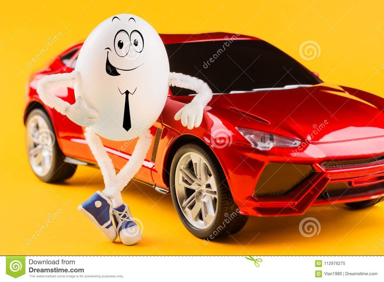 Easter egg businessman near red luxury car