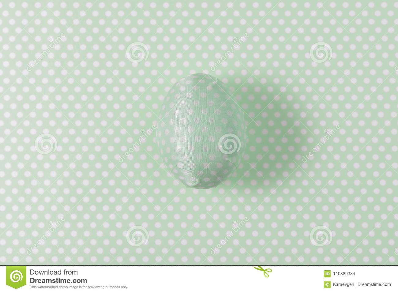 Easter egg decorated with green paper napkin.