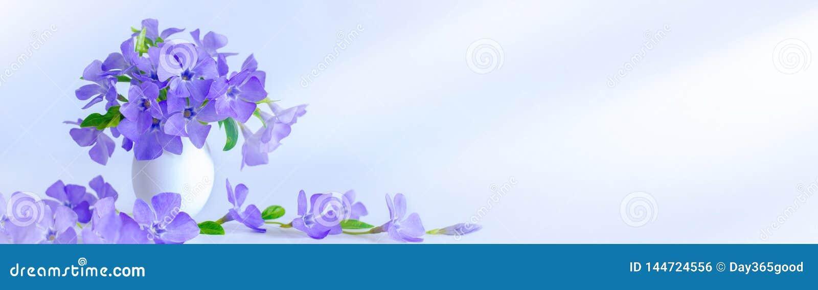 Easter egg and sprig blue flowers on blue background. Easter decoration
