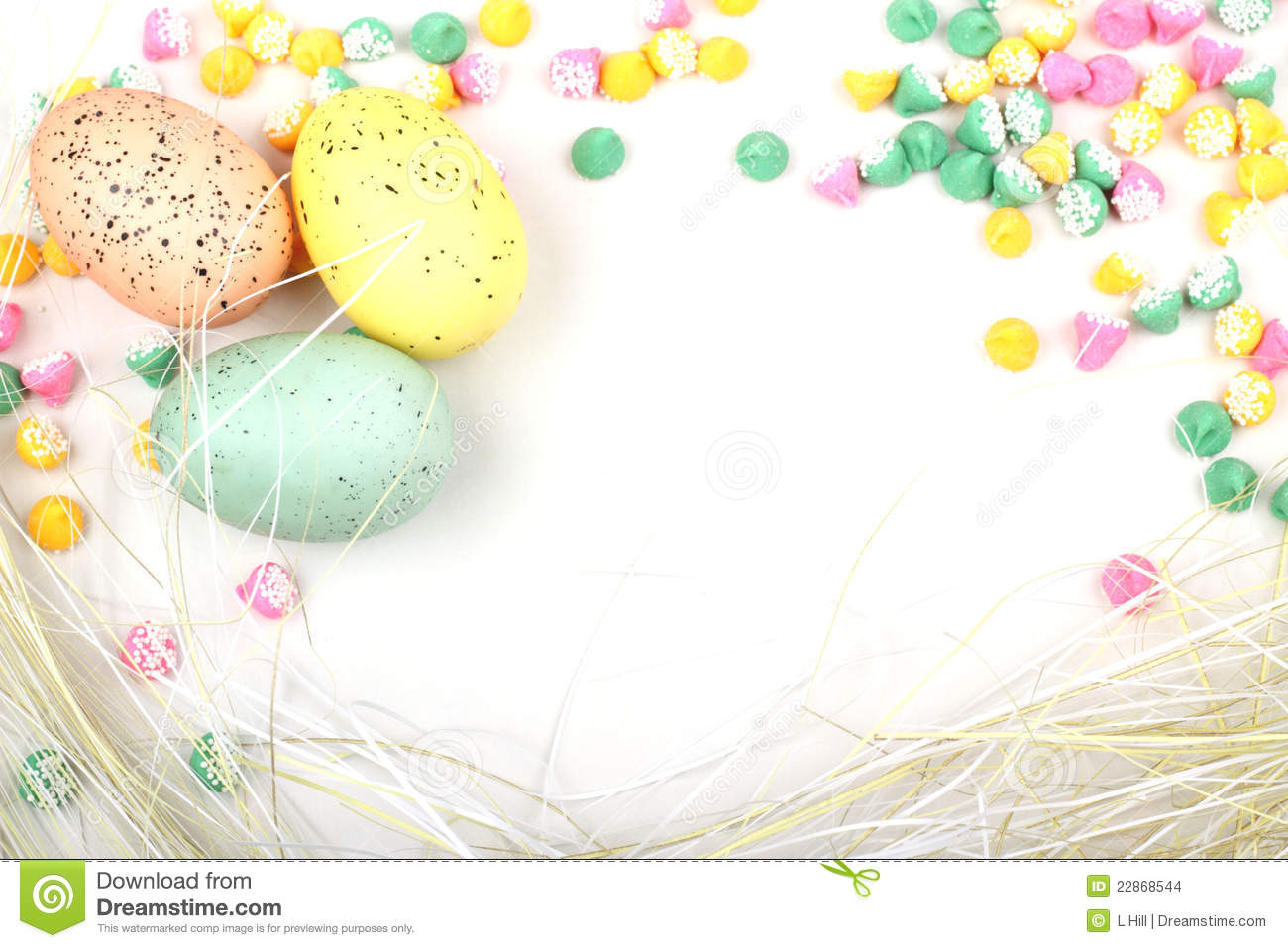 ... Meltie candies, straw and speckled colored Easter eggs. Copy Space