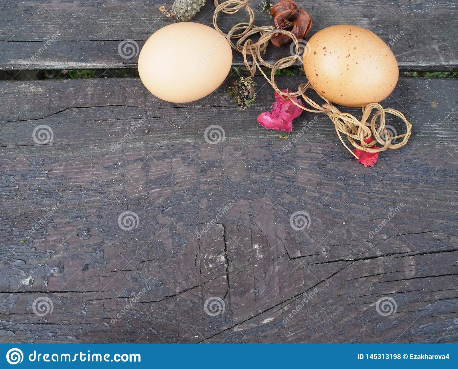 Easter eggs in a basket with decorations on the table