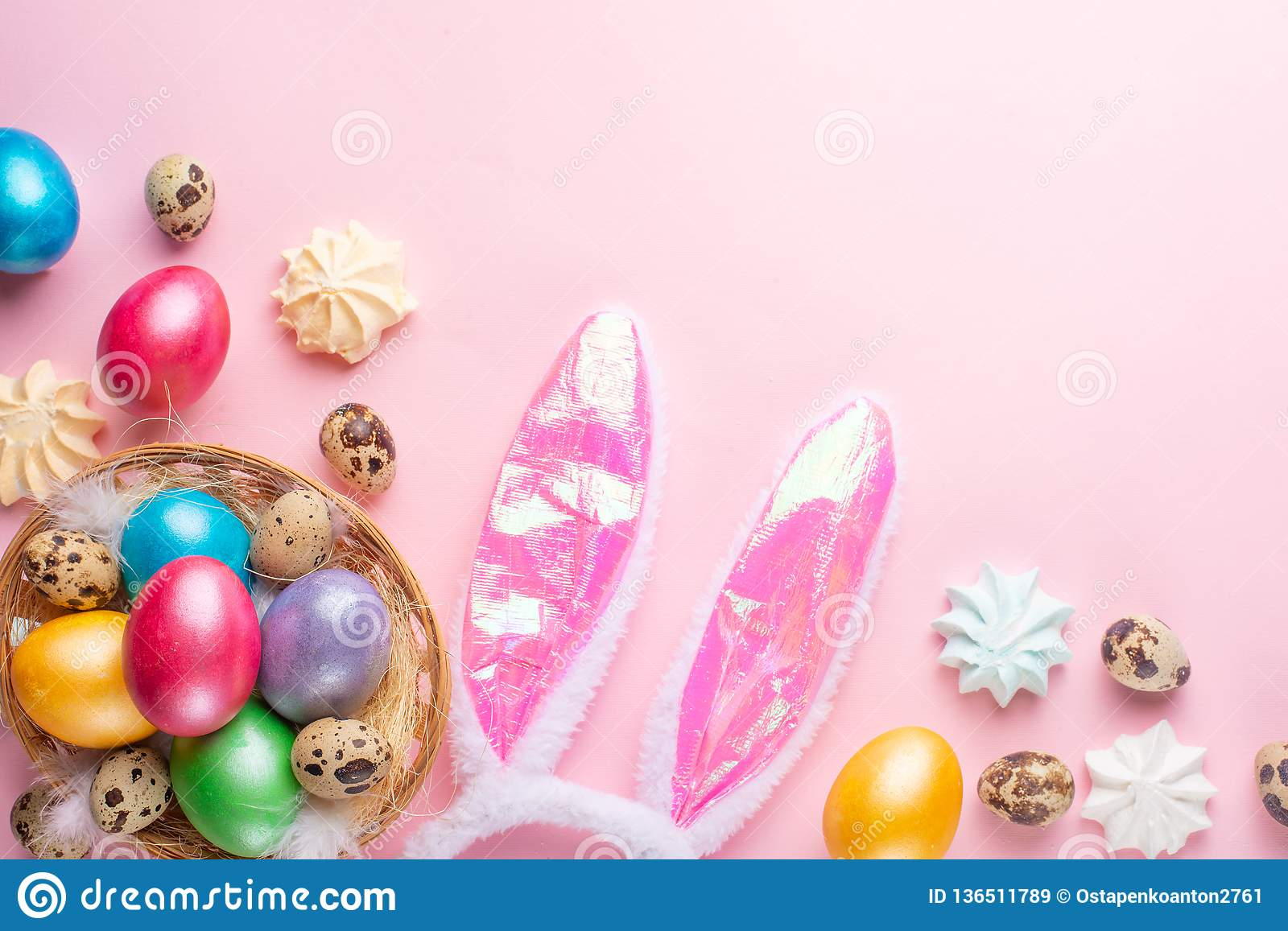 Easter eggs colored with rabbit ears and sweets .flat lay with space for design,horizontal composition. Greeting card concept