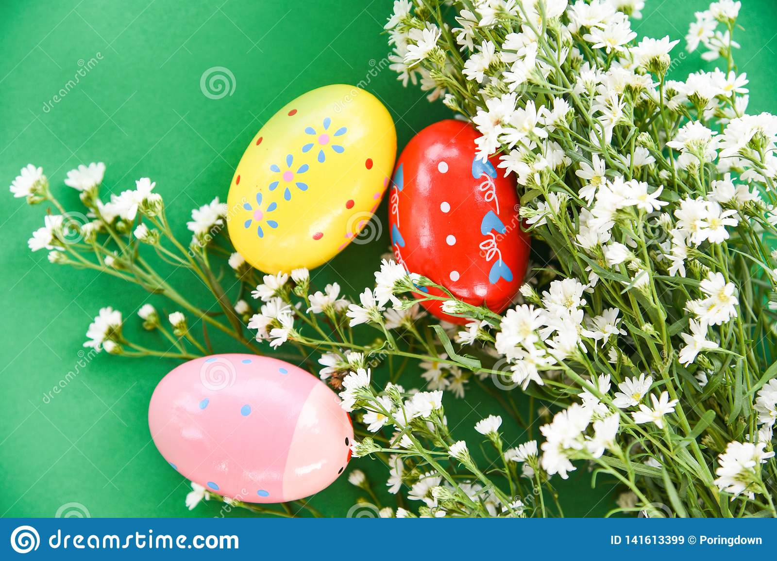 Easter eggs decoration white cutter flower on green background