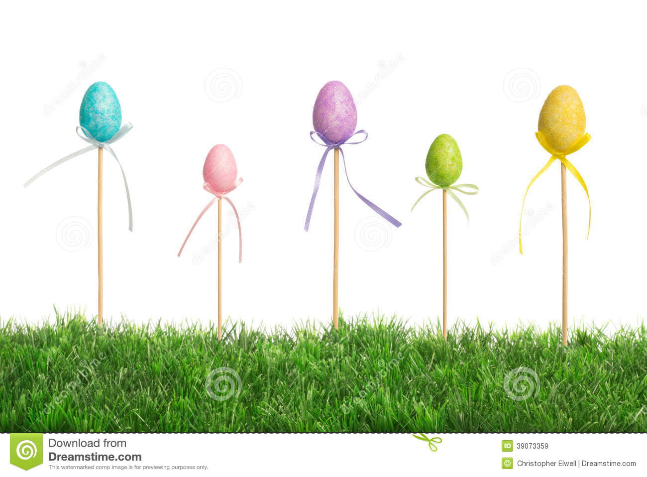 Easter eggs in grass stock image image of yellow purple for Pretty grass